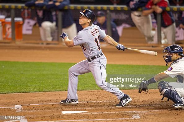 Andy Dirks of the Detroit Tigers bats against the Minnesota Twins on September 25 2013 at Target Field in Minneapolis Minnesota The Tigers defeated...
