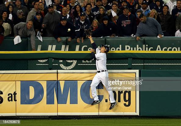 Andy Dirks of the Detroit Tigers can't make a play on a home run ball hit by Eduardo Nunez of the New York Yankees in the ninth inning during game...
