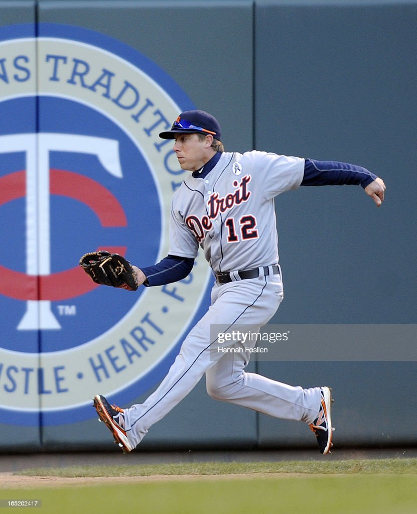 <a gi-track='captionPersonalityLinkClicked' href=/galleries/search?phrase=Andy+Dirks&family=editorial&specificpeople=7511216 ng-click='$event.stopPropagation()'>Andy Dirks</a> #12 of the Detroit Tigers catches a ball in left field during the eighth inning of the Opening Day game against the Minnesota Twins on April 1, 2013 at Target Field in Minneapolis, Minnesota. The Tigers defeated the Twins 4-2.