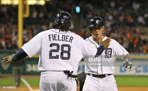 Andy Dirks of the Detroit Tigers celebrates after hitting a threerun home run in the ninth inning scoring Prince Fielder and Victor Martinez during...