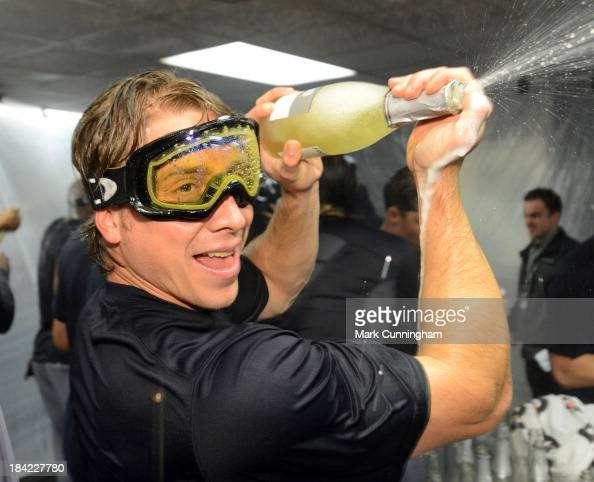 Andy Dirks of the Detroit Tigers celebrates in the locker room after defeating the Oakland Athletics in Game Five of the American League Division...