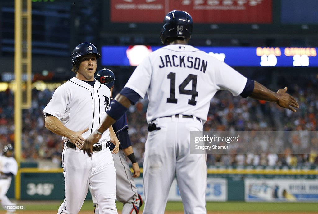 <a gi-track='captionPersonalityLinkClicked' href=/galleries/search?phrase=Andy+Dirks&family=editorial&specificpeople=7511216 ng-click='$event.stopPropagation()'>Andy Dirks</a> of the Detroit Tigers celebrates scoring a third inning run with <a gi-track='captionPersonalityLinkClicked' href=/galleries/search?phrase=Austin+Jackson&family=editorial&specificpeople=608633 ng-click='$event.stopPropagation()'>Austin Jackson</a> #14 while playing the Cleveland Indians at Comerica Park on August 30, 2013 in Detroit, Michigan.