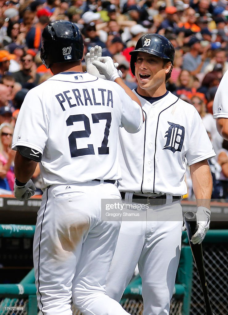 <a gi-track='captionPersonalityLinkClicked' href=/galleries/search?phrase=Andy+Dirks&family=editorial&specificpeople=7511216 ng-click='$event.stopPropagation()'>Andy Dirks</a> #12 of the Detroit Tigers celebrates with <a gi-track='captionPersonalityLinkClicked' href=/galleries/search?phrase=Jhonny+Peralta&family=editorial&specificpeople=213286 ng-click='$event.stopPropagation()'>Jhonny Peralta</a> #27 after Peralta's sixth inning grand slam home run while playing the Philadelphia Phillies at Comerica Park on July 28, 2013 in Detroit, Michigan.