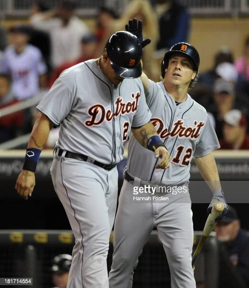 Andy Dirks of the Detroit Tigers congratulates teammate Miguel Cabrera on scoring a run against the Minnesota Twins during the seventh inning of the...