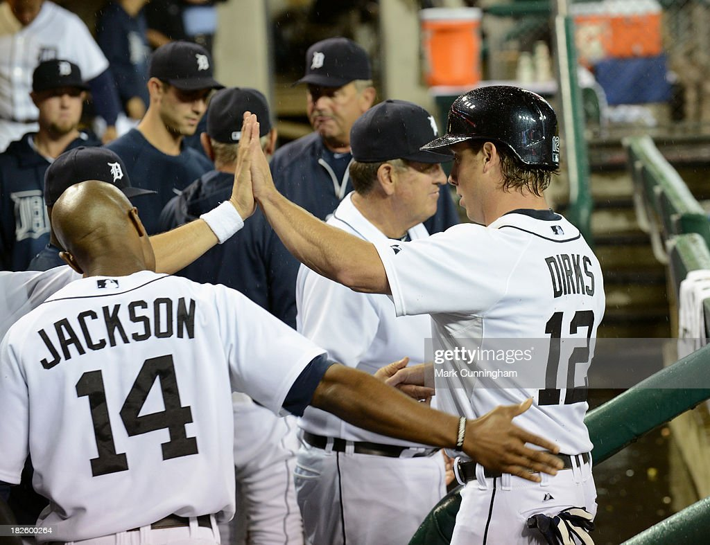 Andy Dirks #12 of the Detroit Tigers gets high-fives from teammates in the dugout during the game against the Chicago White Sox at Comerica Park on September 20, 2013 in Detroit, Michigan. The Tigers defeated the White Sox 12-5.