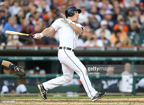 Andy Dirks of the Detroit Tigers hits a solo home run to right field in the third inning of the game against the Minnesota Twins at Comerica Park on...
