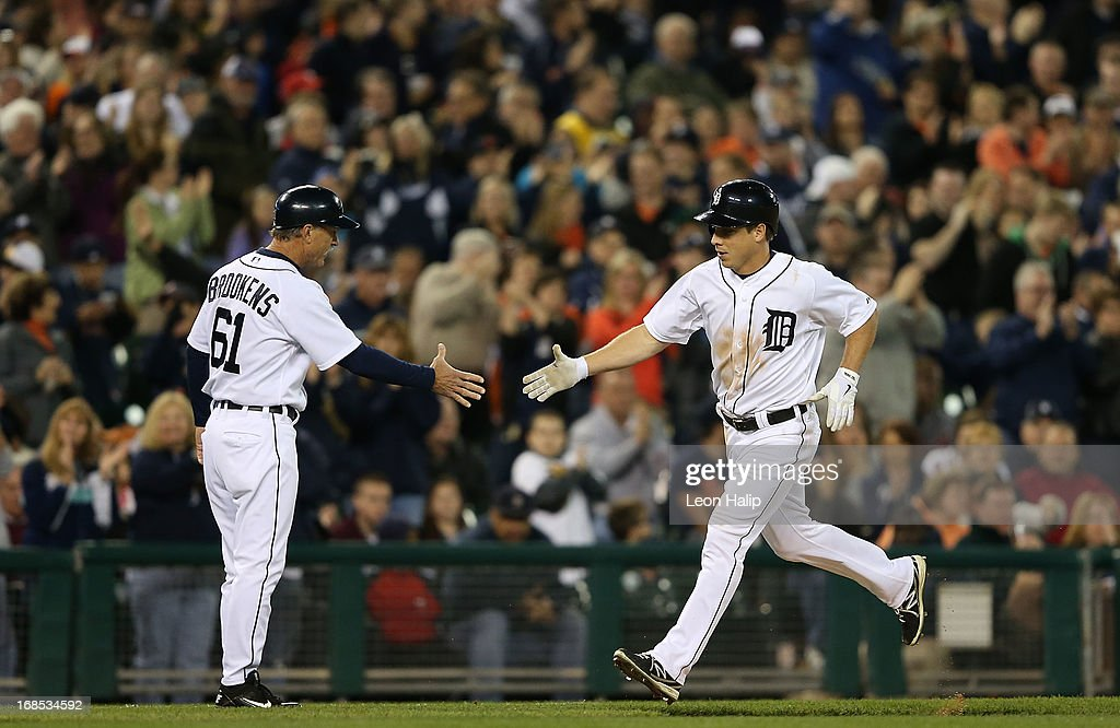 <a gi-track='captionPersonalityLinkClicked' href=/galleries/search?phrase=Andy+Dirks&family=editorial&specificpeople=7511216 ng-click='$event.stopPropagation()'>Andy Dirks</a> #12 of the Detroit Tigers is congratulated by third base coach Tom Brookens #61 after hitting a solo home run to right field in the seventh inning of the game against the Cleveland Indians at Comerica Park on May 10, 2013 in Detroit, Michigan. The Tigers defeated the Indians 10-4.