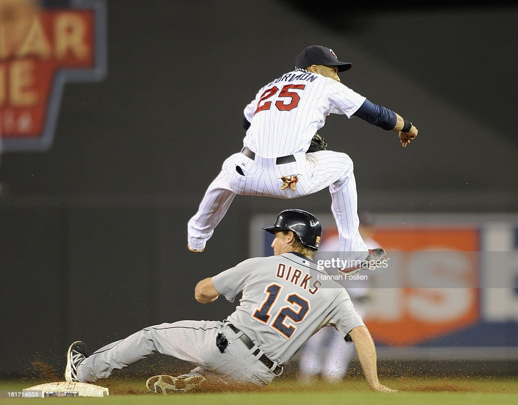 <a gi-track='captionPersonalityLinkClicked' href=/galleries/search?phrase=Andy+Dirks&family=editorial&specificpeople=7511216 ng-click='$event.stopPropagation()'>Andy Dirks</a> #12 of the Detroit Tigers is out at second base as Pedro Florimon #25 of the Minnesota Twins turns a double play during the seventh inning of the game on September 23, 2013 at Target Field in Minneapolis, Minnesota. The Twins defeated the Tigers 4-3 in eleven innings.