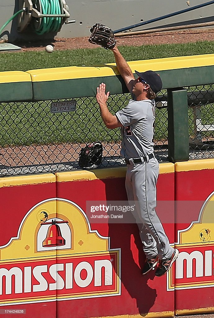 <a gi-track='captionPersonalityLinkClicked' href=/galleries/search?phrase=Andy+Dirks&family=editorial&specificpeople=7511216 ng-click='$event.stopPropagation()'>Andy Dirks</a> #12 of the Detroit Tigers leaps in vain for a home run ball hit by Tyler Flowers of the Chicago White Sox in the 6th inning at U.S. Cellular Field on July 25, 2013 in Chicago, Illinois. The White Sox defeated the Tigers 7-4.