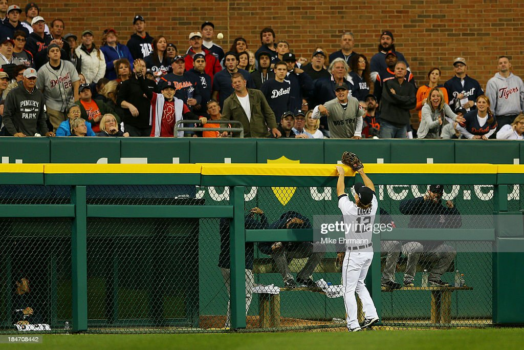 <a gi-track='captionPersonalityLinkClicked' href=/galleries/search?phrase=Andy+Dirks&family=editorial&specificpeople=7511216 ng-click='$event.stopPropagation()'>Andy Dirks</a> #12 of the Detroit Tigers looks on as a homerun hit by Mike Napoli #12 of the Boston Red Sox goes over the wall in the seventh inning during Game Three of the American League Championship Series at Comerica Park on October 15, 2013 in Detroit, Michigan.