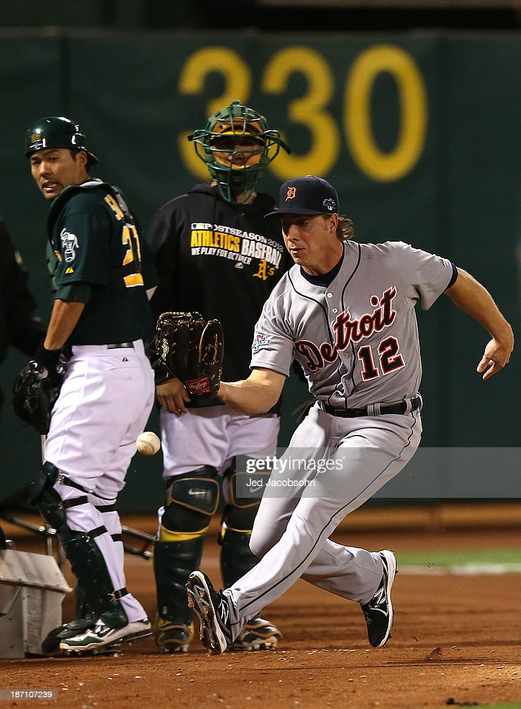 Andy Dirks #12 of the Detroit Tigers misses a foul ball during Game One of the American League Division Series against of the Oakland Athletics on Friday, October 4, 2013 at Oc.o Coliseum in Oakland, California.