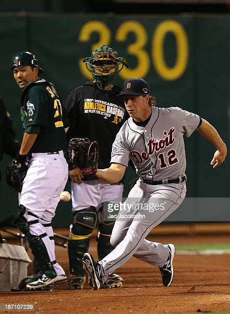 Andy Dirks of the Detroit Tigers misses a foul ball during Game One of the American League Division Series against of the Oakland Athletics on Friday...