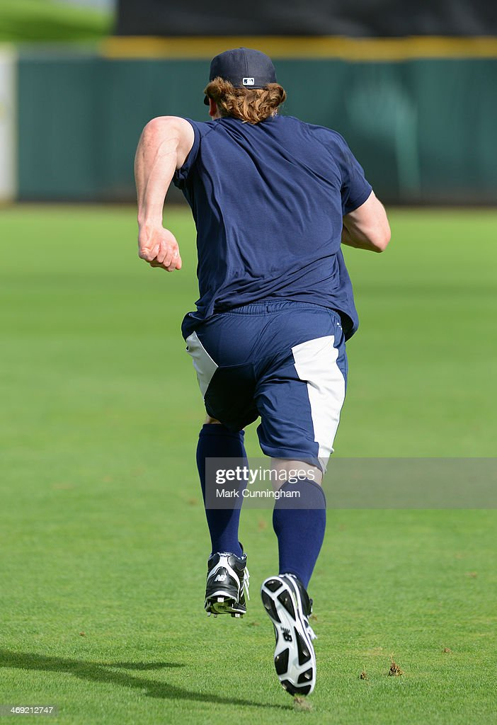 Andy Dirks #12 of the Detroit Tigers runs a sprint on the field during the Tigers workout day at Joker Marchant Stadium on February 13, 2014 in Lakeland, Florida.
