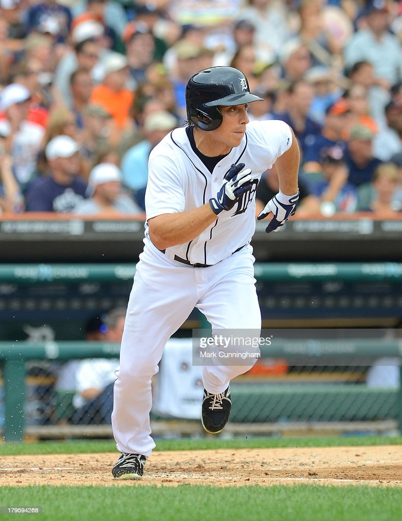 Andy Dirks #12 of the Detroit Tigers runs to first base during the game against the Cleveland Indians at Comerica Park on September 1, 2013 in Detroit, Michigan. The Indians defeated the Tigers 4-0.