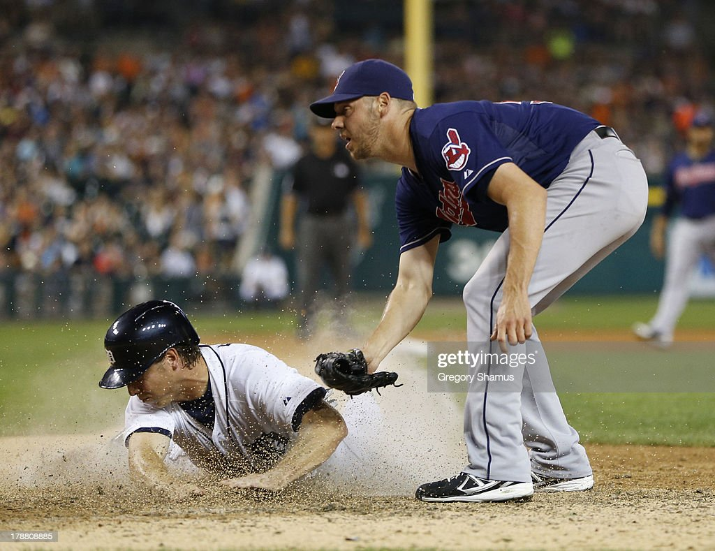 <a gi-track='captionPersonalityLinkClicked' href=/galleries/search?phrase=Andy+Dirks&family=editorial&specificpeople=7511216 ng-click='$event.stopPropagation()'>Andy Dirks</a> #12 of the Detroit Tigers scores on wild pitch by Rick Hill #53 of the Cleveland Indians during the seventh inning at Comerica Park on August 30, 2013 in Detroit, Michigan.