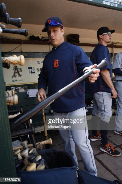 Andy Dirks of the Detroit Tigers stands in the dugout prior to the game against the Oakland Athletics at Oco Coliseum on April 13 2013 in Oakland...