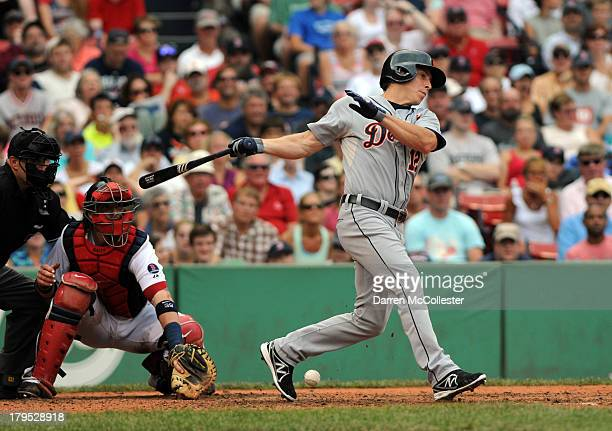 Andy Dirks of the Detroit Tigers swings at a pitch in the seventh inning against the Boston Red Sox at Fenway Park on September 2 2013 in Boston...