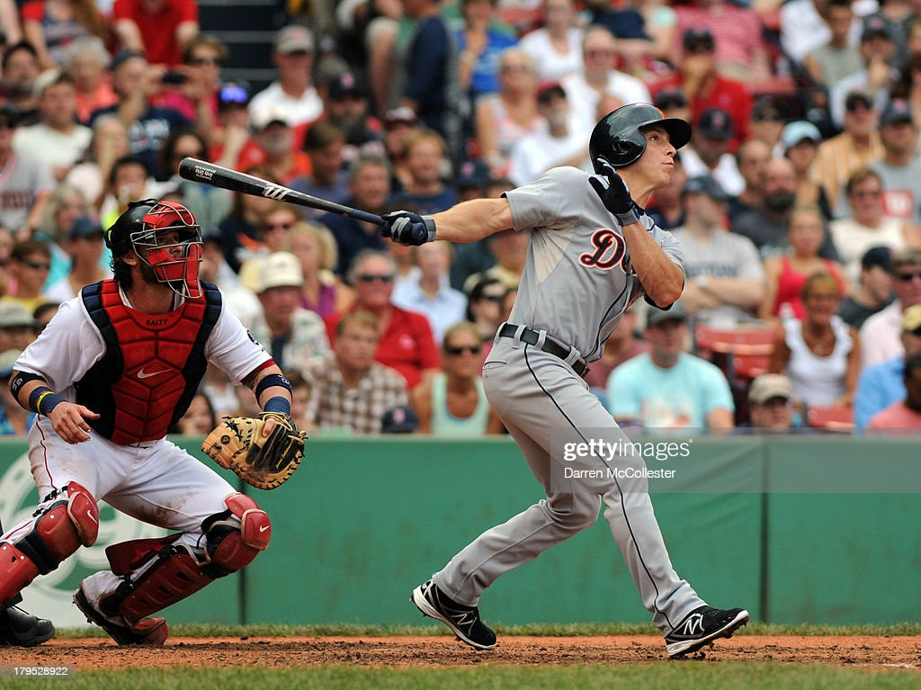 Andy Dirks #12 of the Detroit Tigers swings at a pitch in the seventh inning against the Boston Red Sox at Fenway Park on September 2, 2013 in Boston, Massachusetts. The Tigers won 3-0.