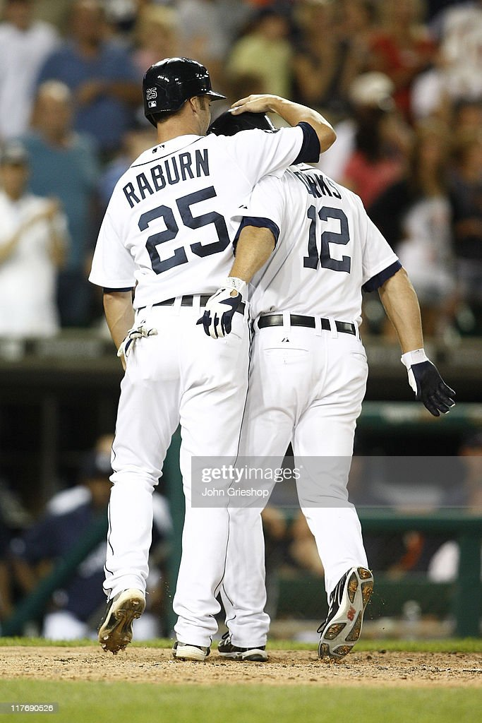 Andy Dirks #12 receives congratulations from <a gi-track='captionPersonalityLinkClicked' href=/galleries/search?phrase=Ryan+Raburn&family=editorial&specificpeople=2541483 ng-click='$event.stopPropagation()'>Ryan Raburn</a> #25 of the Detroit Tigers after connecting for a homerun during the game against the New York Mets on June 29, 2011 at Comerica Park in Detroit, Michigan. The Mets defeated the Tigers 16-9.