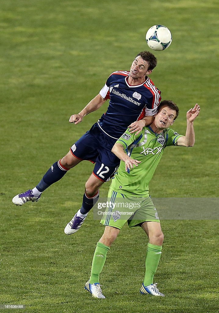 <a gi-track='captionPersonalityLinkClicked' href=/galleries/search?phrase=Andy+Dorman&family=editorial&specificpeople=586204 ng-click='$event.stopPropagation()'>Andy Dorman</a> #12 of the New England Revolution goes up for a header against DeAndre Yedlin #7 of the Seattle Sounders during the second half of the FC Tucson Desert Diamond Cup at Kino Sports Complex on February 13, 2013 in Tucson, Arizona. The Sounders defeated the Revolution 2-0.