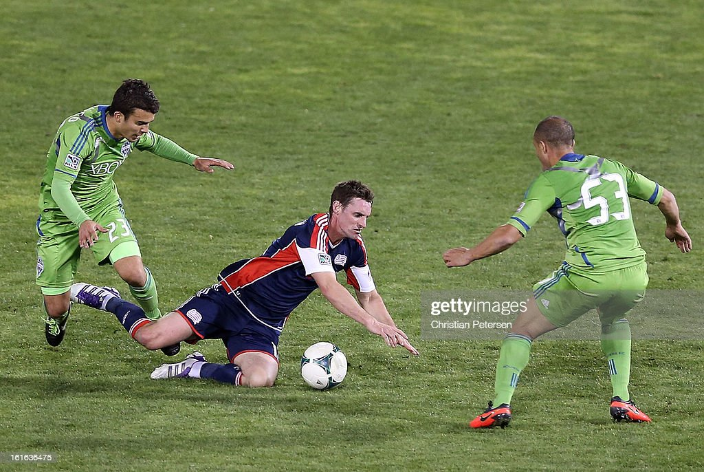 <a gi-track='captionPersonalityLinkClicked' href=/galleries/search?phrase=Andy+Dorman&family=editorial&specificpeople=586204 ng-click='$event.stopPropagation()'>Andy Dorman</a> #12 of the New England Revolution is tripped up by Servando Carrasco #23 of the Seattle Sounders during the second half of the FC Tucson Desert Diamond Cup at Kino Sports Complex on February 13, 2013 in Tucson, Arizona. The Sounders defeated the Revolution 2-0.