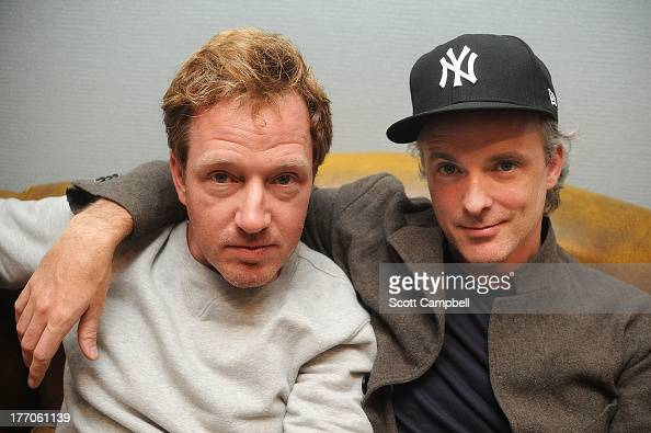 Andy Dunlop and Fran Healy of Travis pose for a portrait before the Absolute Radio Sessions at Hard Rock Cafe on August 20 2013 in Edinburgh Scotland