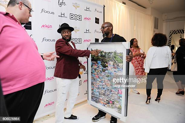 Andy Elisburg and Bob Metelus attend Haitian photographer Bob Metelus unveils newest collection Haiti A Collective Cry from a Forgotten Paradise on...