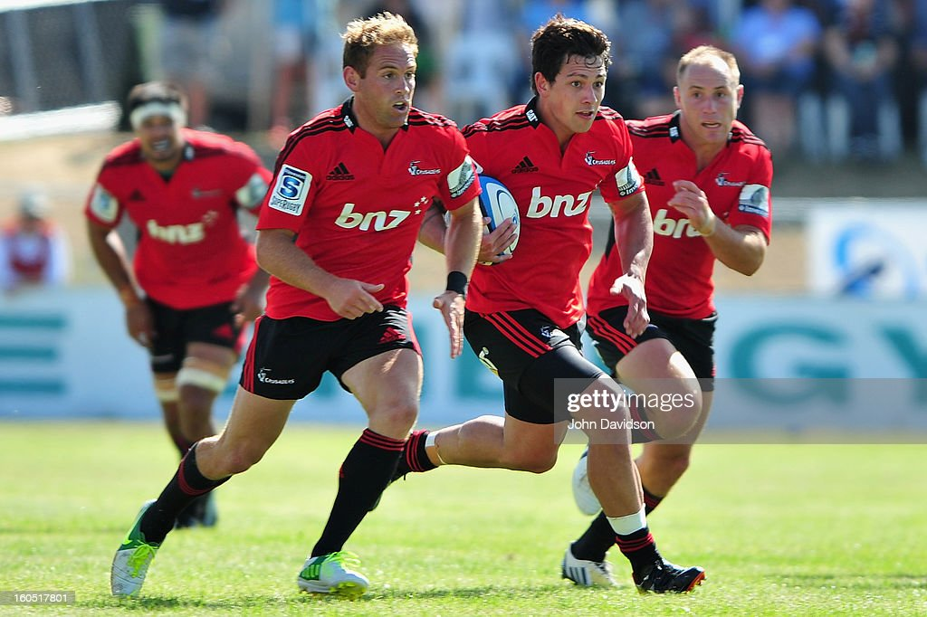 Andy Ellis(left), James Schrader and Willie Heinz(right) on attack during the 2013 Super Rugby pre-season friendly match between the Crusaders and the Hurricanes at Alpine Stadium on February 2, 2013 in Timaru, New Zealand.