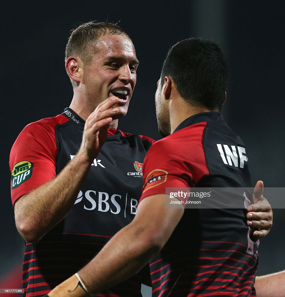 Andy Ellis of Canterbury congratulates Milford Keresoma during the round 7 ITM Cup match between Canterbury and Manawatu at AMI Stadium on September 25, 2013 in Christchurch, New Zealand.