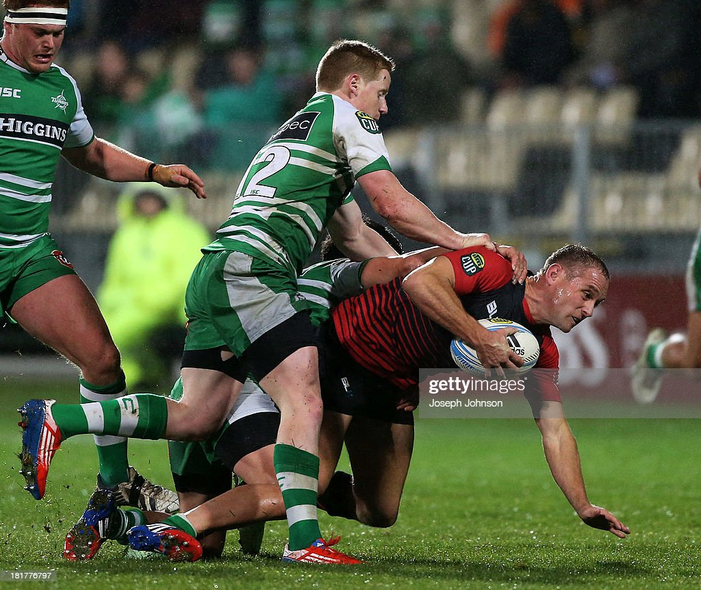 Andy Ellis of Canterbury is tackled by Hamish Northcott of Manawatu during the round 7 ITM Cup match between Canterbury and Manawatu at AMI Stadium on September 25, 2013 in Christchurch, New Zealand.