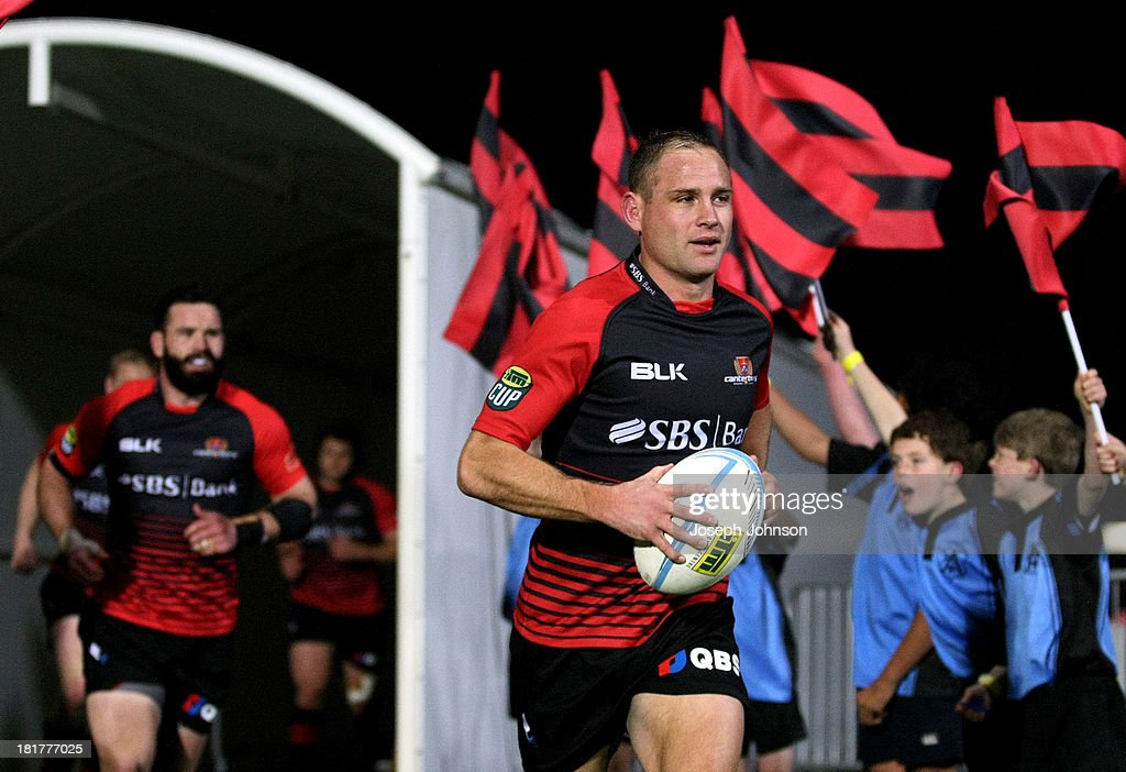Andy Ellis of Canterbury leads the team out as captain before the round 7 ITM Cup match between Canterbury and Manawatu at AMI Stadium on September 25, 2013 in Christchurch, New Zealand.