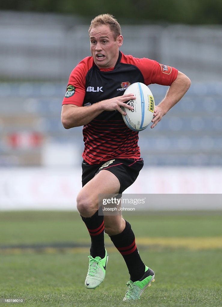 Andy Ellis of Canterbury with the ball during the round eight ITM Cup match between Cantebury and Counties Manukau at AMI Stadium on October 6, 2013 in Christchurch, New Zealand.