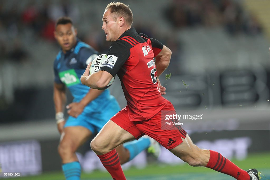 Andy Ellis of the Crusaders makes a break during the round 14 Super Rugby match between the Blues and the Crusaders at Eden Park on May 28, 2016 in Auckland, New Zealand.