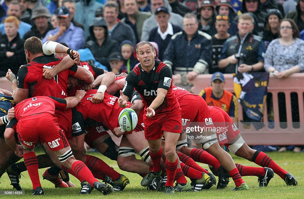 Andy Ellis of the Crusaders passes the ball during the Super Rugby trial match between the Highlanders and the Crusaders at Fred Booth Park on February 11, 2016 in Waimumu, New Zealand.