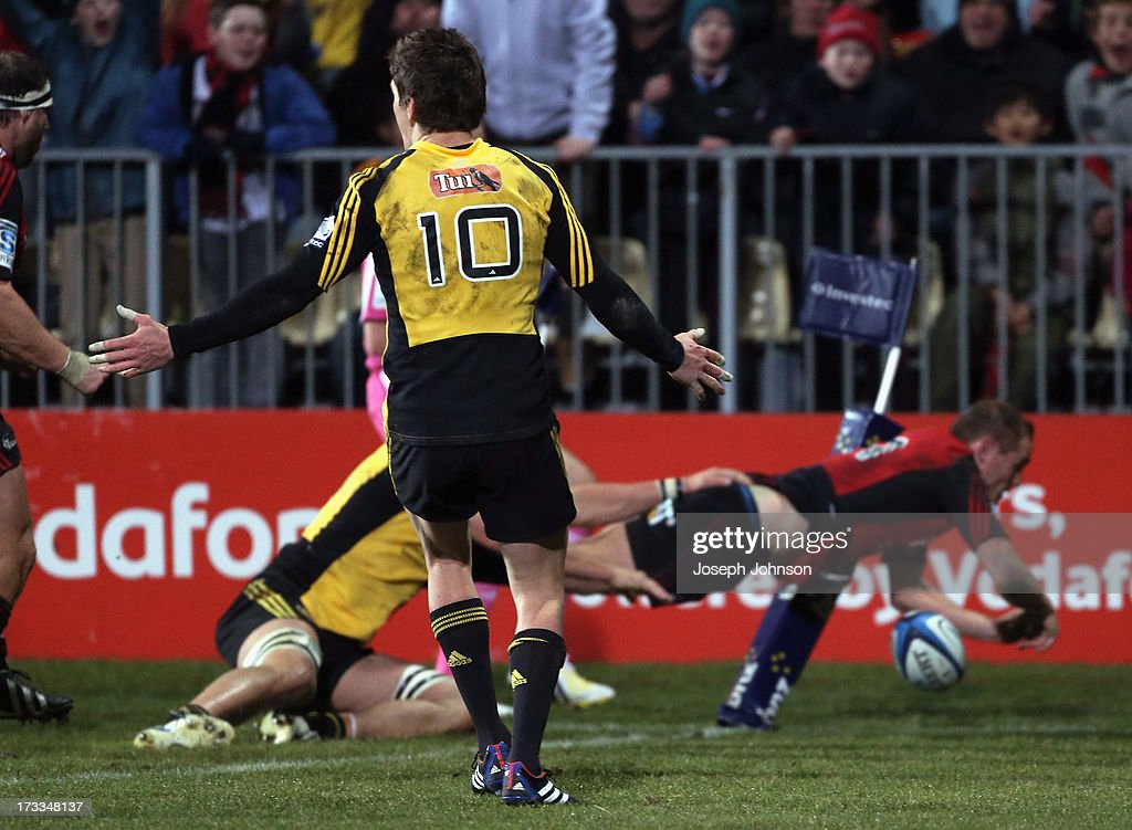 Andy Ellis of the Crusaders scores a try with Beauden Barrett of the Hurricanes gesturing to the referee during the round 20 Super Rugby match between the Crusaders and the Hurricanes at AMI Stadium on July 12, 2013 in Christchurch, New Zealand.