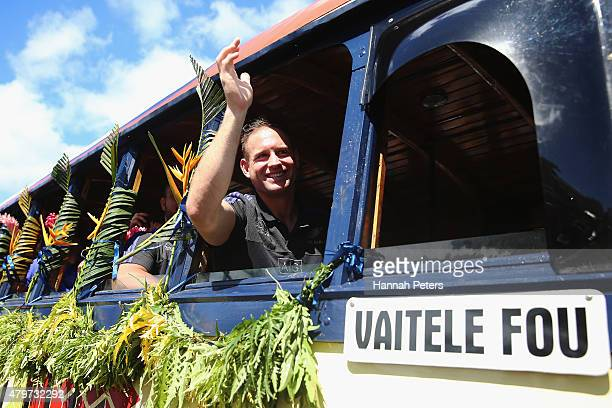Andy Ellis of the New Zealand All Blacks waves to fans during a parade down the main street of Apia on July 7 2015 in Apia Samoa