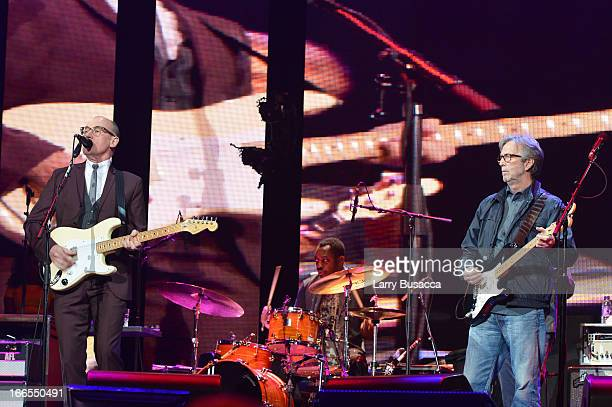 Andy Fairweather Low and Eric Clapton perform on stage during the 2013 Crossroads Guitar Festival at Madison Square Garden on April 13 2013 in New...