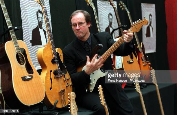 Andy Fairweather Lowe of Amen Corner with some of Eric Clapton's guitars which are on view at Christie's London ahead of the New York auction of his...