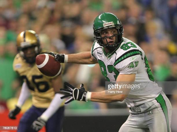 Andy Fantuz of the Saskatchewan Rough Riders races to the end zone to score a touchdown in front of Kliff Kingsbury of the Winnipeg Blue Bombers...