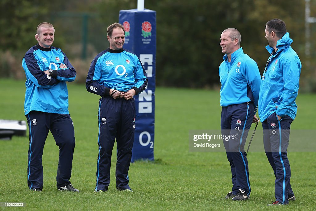 Andy Farrell backs coach Stuart Lancaster the England head coach Mike Catt and Graham Rowntree the forwards coach look on during the England training...
