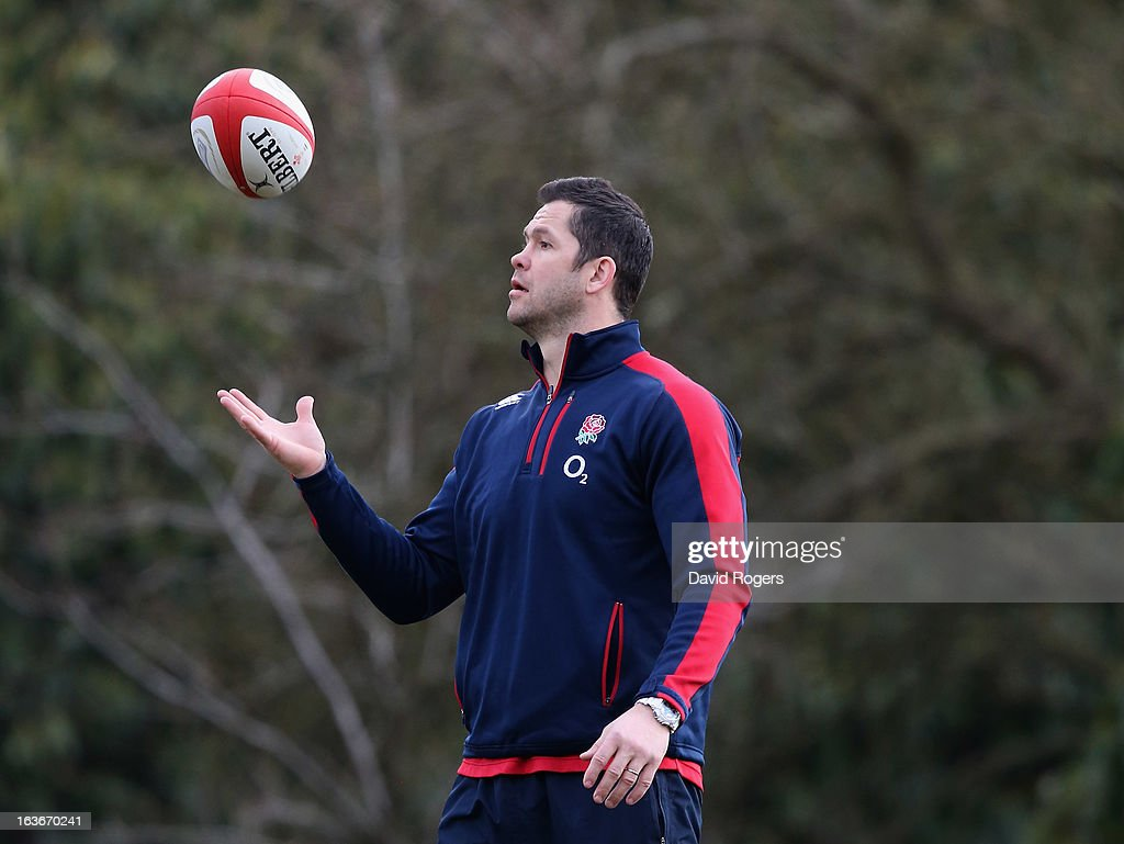 Andy Farrell, the backs coach catches the ball during the England training session at Pennyhill Park on March 14, 2013 in Bagshot, England.