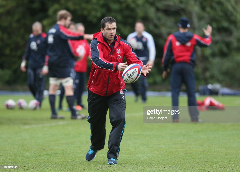 Andy Farrell, the England backs coach passes the ball during the England training session at Pennyhill Park on January 29, 2013 in Bagshot, England.