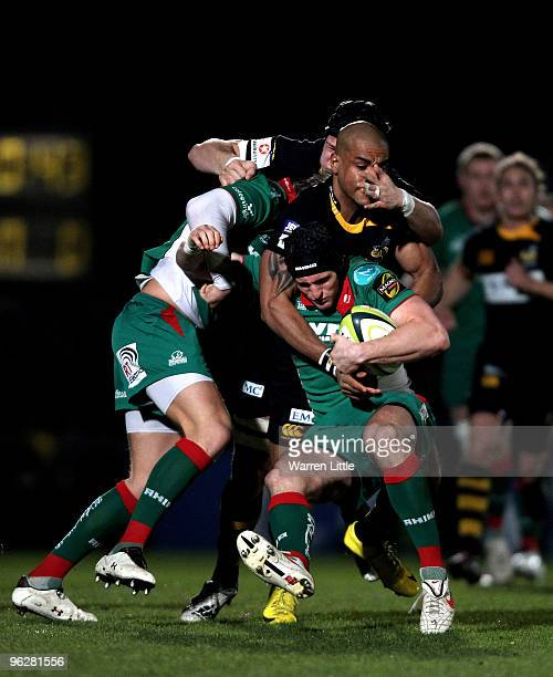 Andy Fenby of Llanelli Scarlets is tackled by Tom Varndell of London Wasps during the LV=Cup between London Wasps and Llanelli Scarlets at Adams Park...