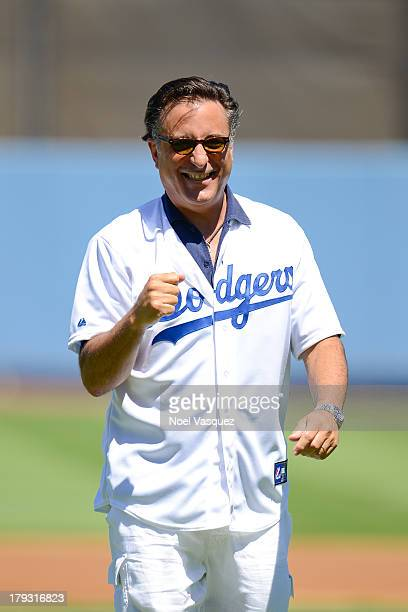 Andy Garcia throws the ceremonial pitch at a baseball game between the San Diego Padres and the Los Angeles Dodgers at Dodger Stadium on September 1...