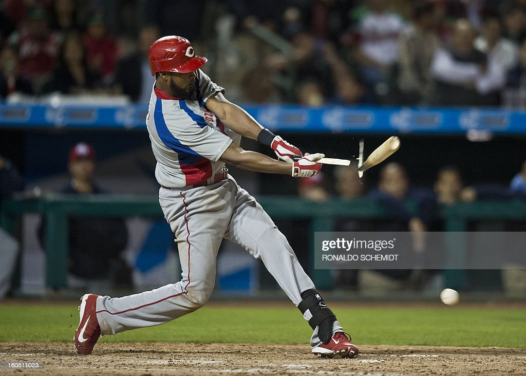 Andy Gonzalez of Criollos de Caguas of Puerto Rico bats against Yaquis de Obregon of Mexico, at the Sonora Stadium, during the 2013 Baseball Caribbean Series, on February 1, 2013, in Hermosillo, Sonora State, northern Mexico. AFP PHOTO/Ronaldo Schemidt