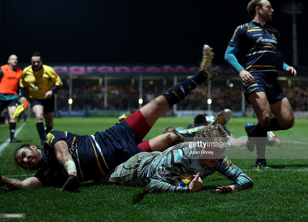 <a gi-track='captionPersonalityLinkClicked' href=/galleries/search?phrase=Andy+Goode&family=editorial&specificpeople=211564 ng-click='$event.stopPropagation()'>Andy Goode</a> of Worcester attempts to stop Scott Hamilton of Leicester Tigers from scoring a try during the Aviva Premiership match between Worcester Warriors and Leicester Tigers at Sixways Stadium on January 4, 2013 in Worcester, England.