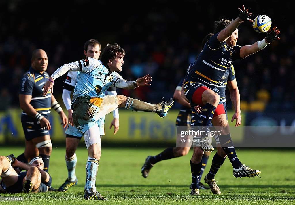 Andy Goode of Worcester charges down a kick from Lee Dickson of Northampton during the Aviva Premiership match between Worcester Warriors and Northampton Saints at Sixways Stadium on February 16, 2013 in Worcester, England.