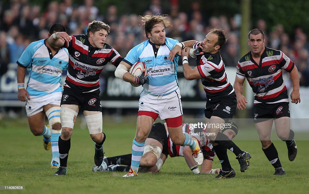 Andy Goode of Worcester is tackled by Gavin Cattle and Philip Burgess during the RFU Championship playoff final 1st Leg match between Cornish Pirates...