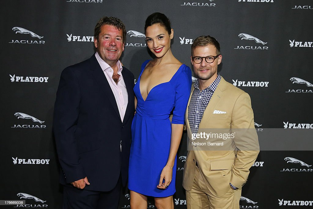 Andy Goss, President, Jaguar Land Rover North America, actress <a gi-track='captionPersonalityLinkClicked' href=/galleries/search?phrase=Gal+Gadot&family=editorial&specificpeople=4350069 ng-click='$event.stopPropagation()'>Gal Gadot</a> and Jeff Curry, Brand Vice President, Jaguar North America attend the Jaguar and Playboy Magazine exclusive VIP reception to celebrate Jaguar's high-performance models during Pebble Beach weekend on August 16, 2013 in Monterey, California.