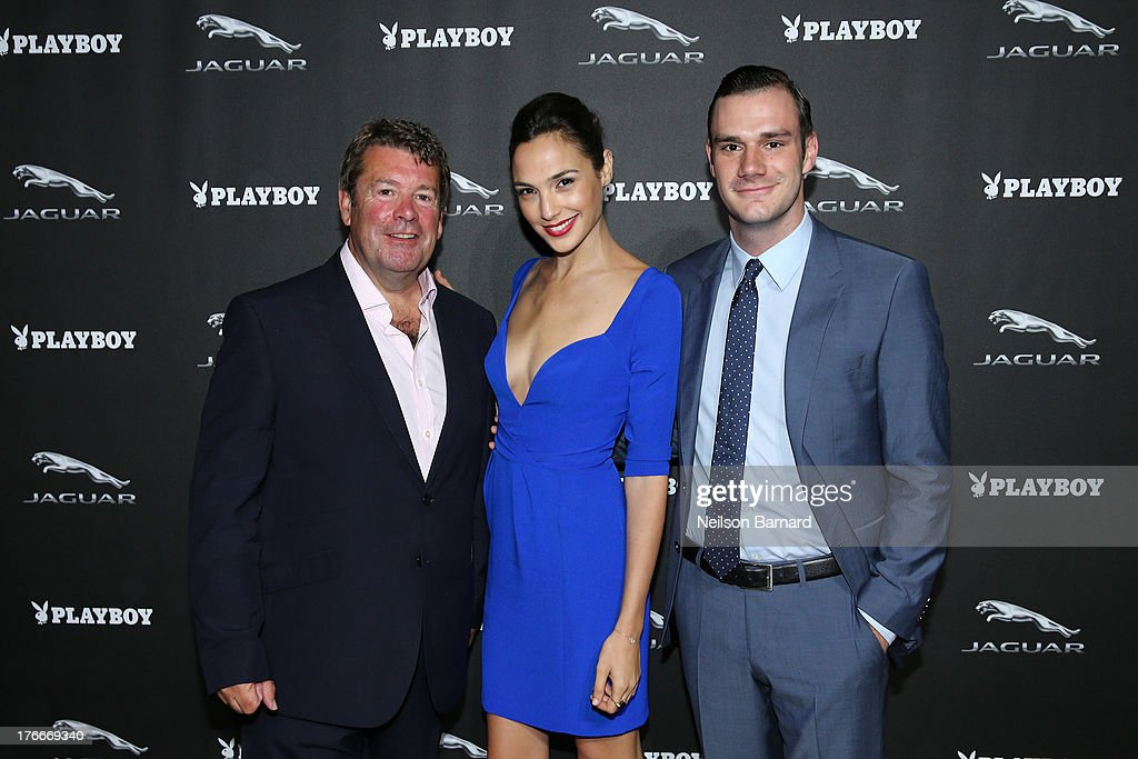 Andy Goss, President, Jaguar Land Rover North America, actress <a gi-track='captionPersonalityLinkClicked' href=/galleries/search?phrase=Gal+Gadot&family=editorial&specificpeople=4350069 ng-click='$event.stopPropagation()'>Gal Gadot</a> and Cooper Hefner attend the Jaguar and Playboy Magazine exclusive VIP reception to celebrate Jaguar's high-performance models during Pebble Beach weekend on August 16, 2013 in Monterey, California.